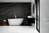 Nowoczesna łazienka w marmurze z wanną wolnostojącą IÖ Tromso