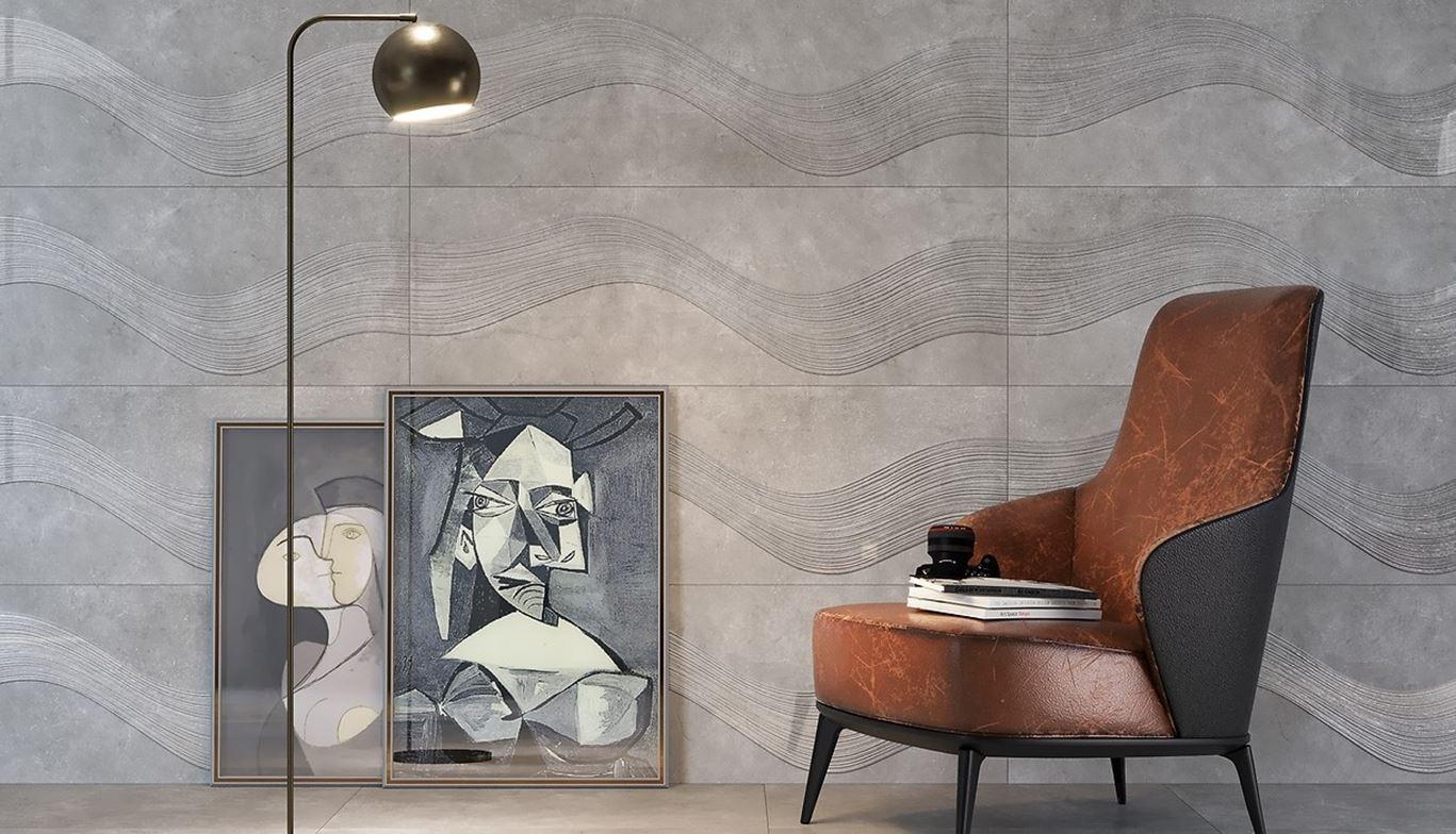 Ściana z szarą płytką strukturalną z rysunkiem fal