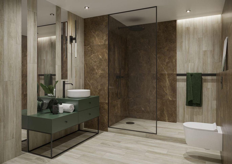 Aranżacja łazienki wykończonej kamieniem i jasnym drewnem