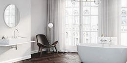 Biała łazienka z jodełkową podłogą w klasycznym wydaniu