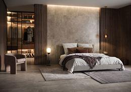 Nastrojowe wnętrze sypialni w szarym kamieniu i drewnie