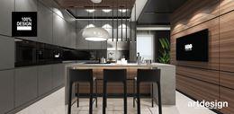 Nowoczesna kuchnia z minimalistyczną zabudową i wyspą