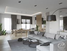 Otwarty salon z szarym wypoczynkowym narożnikiem