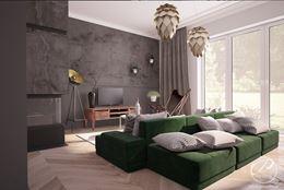 Dwustronna, zielona kanapa w salonie z kamienną ścianą