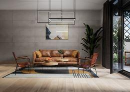 Nowoczesny salon w drewnie i wielkoformatowym betonie