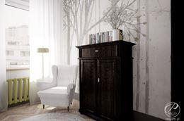 Biały fotel do karmienia na tle jasnej tapety