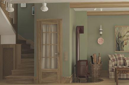 Klimatyczny kominek-koza w zielonym salonie