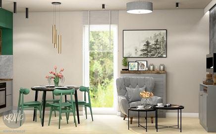 Mała jadalnia z zielonymi krzesłami w salonie