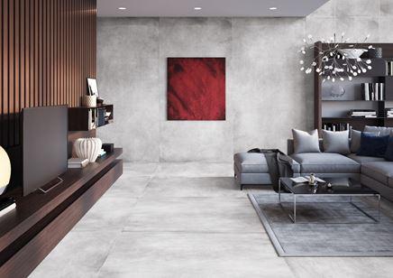 Aranżacja dużego salonu z betonową płytką wielkoformatową
