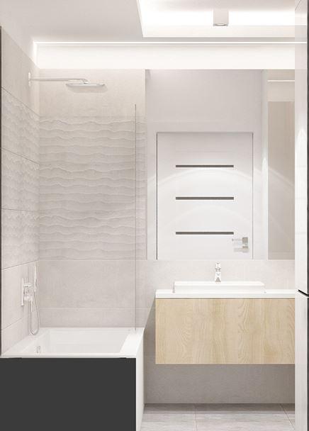 Biała łazienka z wanną w zabudowie