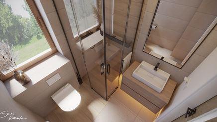 Łazienka z oknem nad stelażem WC
