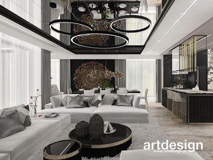 Salon otwarty na kuchnię i jadalnię z dekoracyjną mandalą