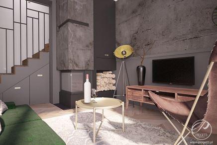 Salon z telewizorem i kominkiem w ciemnym kamieniu