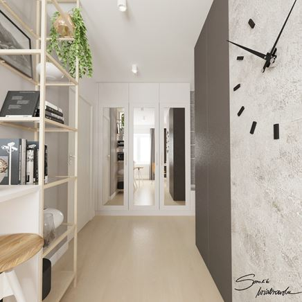 Skandynawski korytarz z białą zabudową