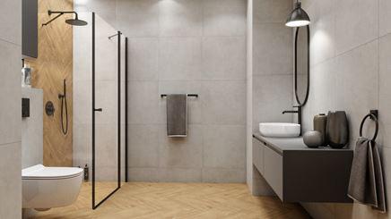 Szara łazienka z jodełkowymi płytkami w kolorze drewna