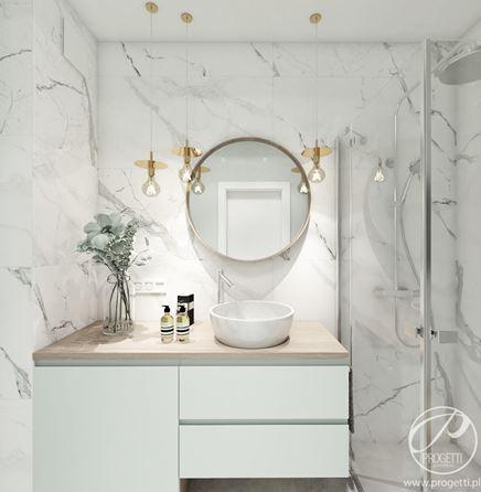 Biała łazienka z marmurowymi płytkami wielkoformatowymi