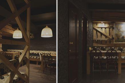 Wnętrze pizzerii w czerni i drewnie