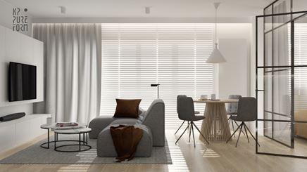 Biały salon z industrialnymi akcentami i szarą kanapą