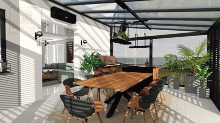 Jadalnia w otwartym na salon zimowym, przeszklonym ogrodzie