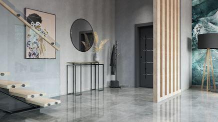 Minimalistyczny korytarz wykończony kamiennymi płytami