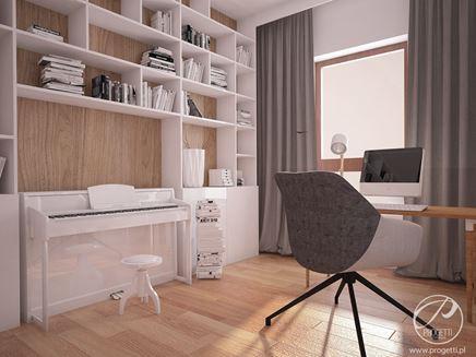 Biuro do pracy w domu z bielą i jasnym drewnem