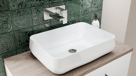 Połączenie białej umywalki nabalatowej z ciemno zielonymi płytkami inspirowanymi orientem