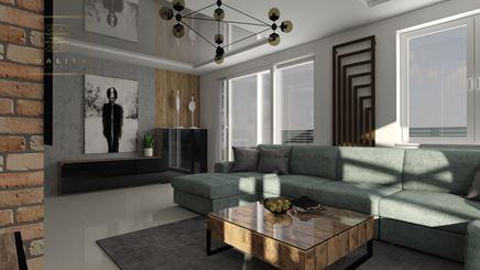 Duży, czarny grzejnik dekoracyjny nad kanapą w salonie
