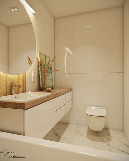 Biała zabudowa w małej łazience