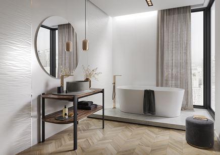 Biała łazienka ze strukturą i jodełkową podłogą