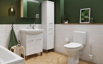 Biało-zielona łazienka z umywalką meblową i kompaktem WC