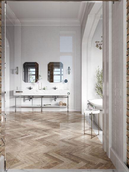 Biała łazienka z jodełkową podłogą