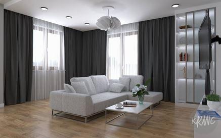 Salon z dużą sofą w salonie