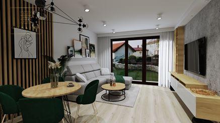 Otwarty salon z dużym oknem