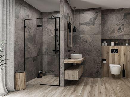Wielkoformatowy szary kamień w łazience z dodatkiem drewna