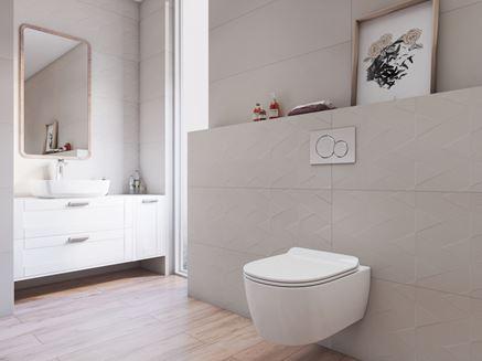 Strefa toaletowa wykończona płytkami w subtelne wzory