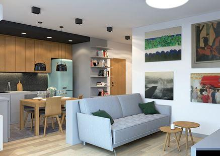 Niewielki salon z szaroniebieską kanapą