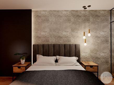 Modna betonowa ściana w sypialni