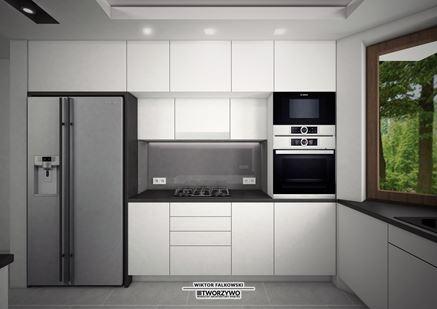 Białe szafki kuchenne w strefie przygotowywania posiłków