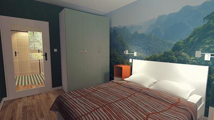 Sypialnia z górską fototapetą