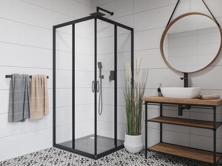 Czarna kabina prysznicowa w połączeniu z ozdobną patchworkową płytką