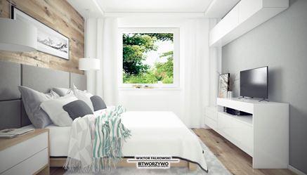 Przytulna sypialnia z drewnem na ścianie