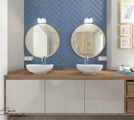 Strefa umywalkowa dla dwojga z niebieskimi płytkami