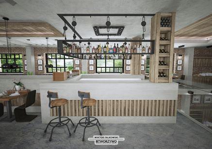 Bar z industrialną zabudową w starej fabryce