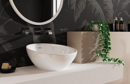 Asymetryczna umywalka stawiana na blacie Roca Bol