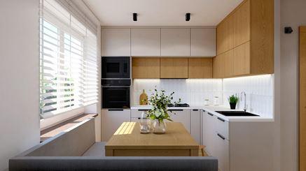 Biała kuchnia z wysokimi szafkami w drewnie