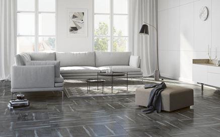 Minimalistyczny salon zdobiony kamieniem - Cersanit Rosta
