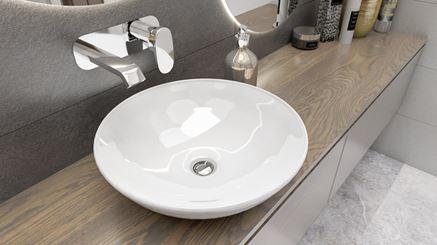Okrągła umywalka stawiana na blacie z baterią podtynkową jednouchwytową