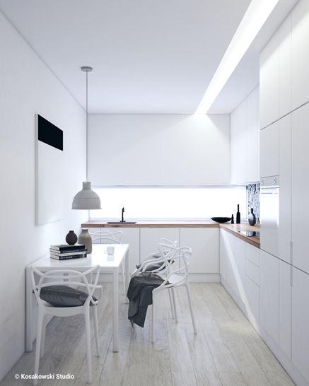 Biała, zamnięta kuchnia ze stołem jadalnym