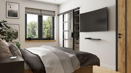 Jasna sypialnia z garderobą i podłogą w drewnie