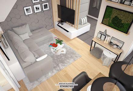 Mały salon z dodatkiem betonu i drewna